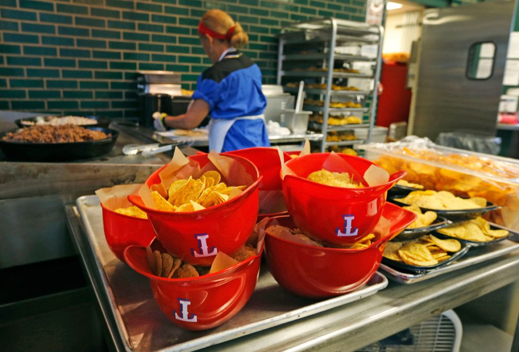 Helmets full of nachos stand at the ready at the concession stand in the center field plaza before the Toronto Blue Jays vs. the Texas Rangers major league baseball ALDS Game 2 at Globe Life Park in Arlington,Texas on Friday, October 7, 2016. (Louis DeLuca/The Dallas Morning News)