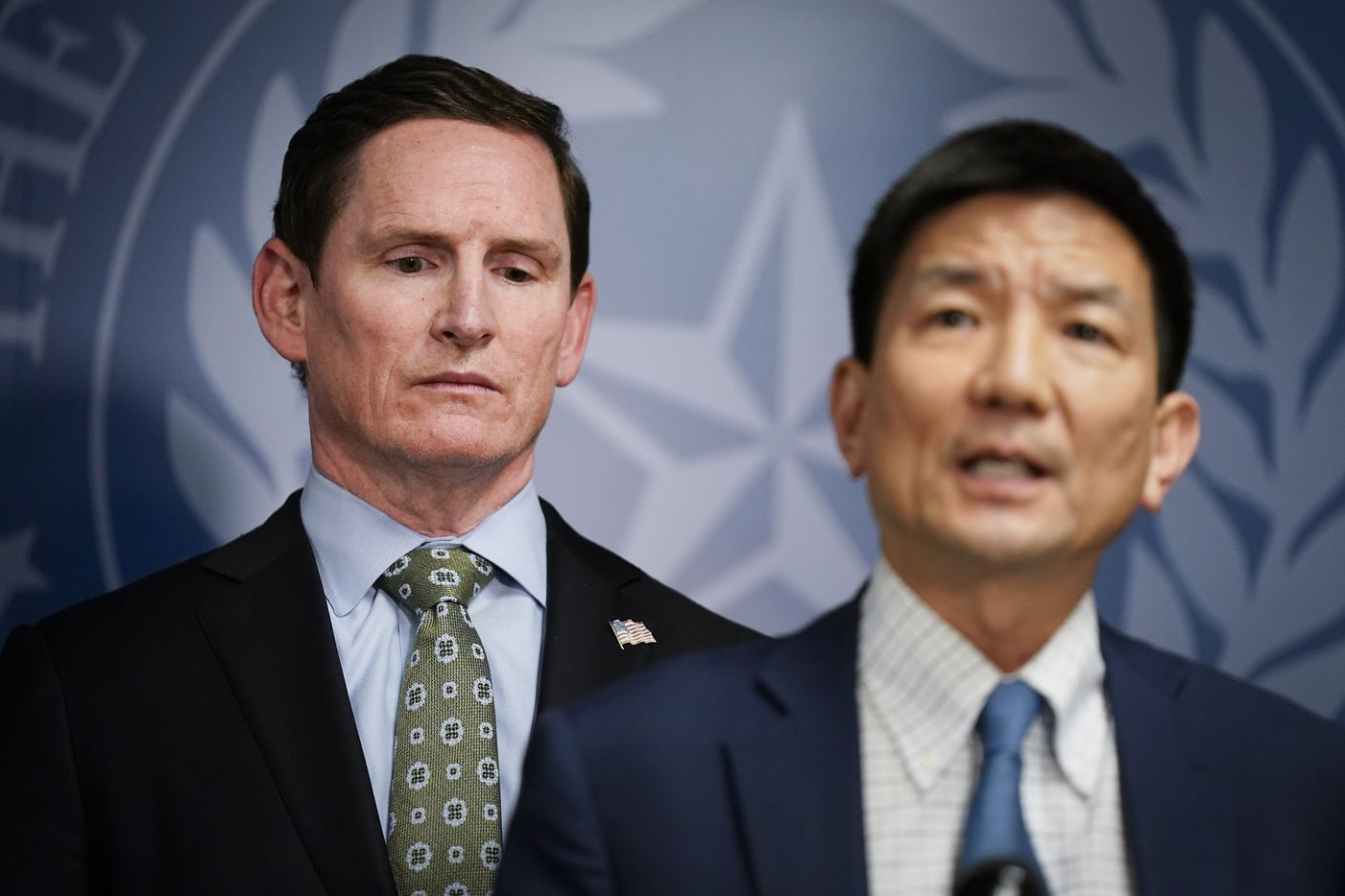Dallas County Judge Clay Jenkins (left) listens as Dr. Philip Huang, Director of Dallas County Health and Human Services, addresses the local state of disaster for public health emergency that has been declared in the county, due to more cases of the new coronavirus, late Thursday, March 12. 2020, in Dallas.