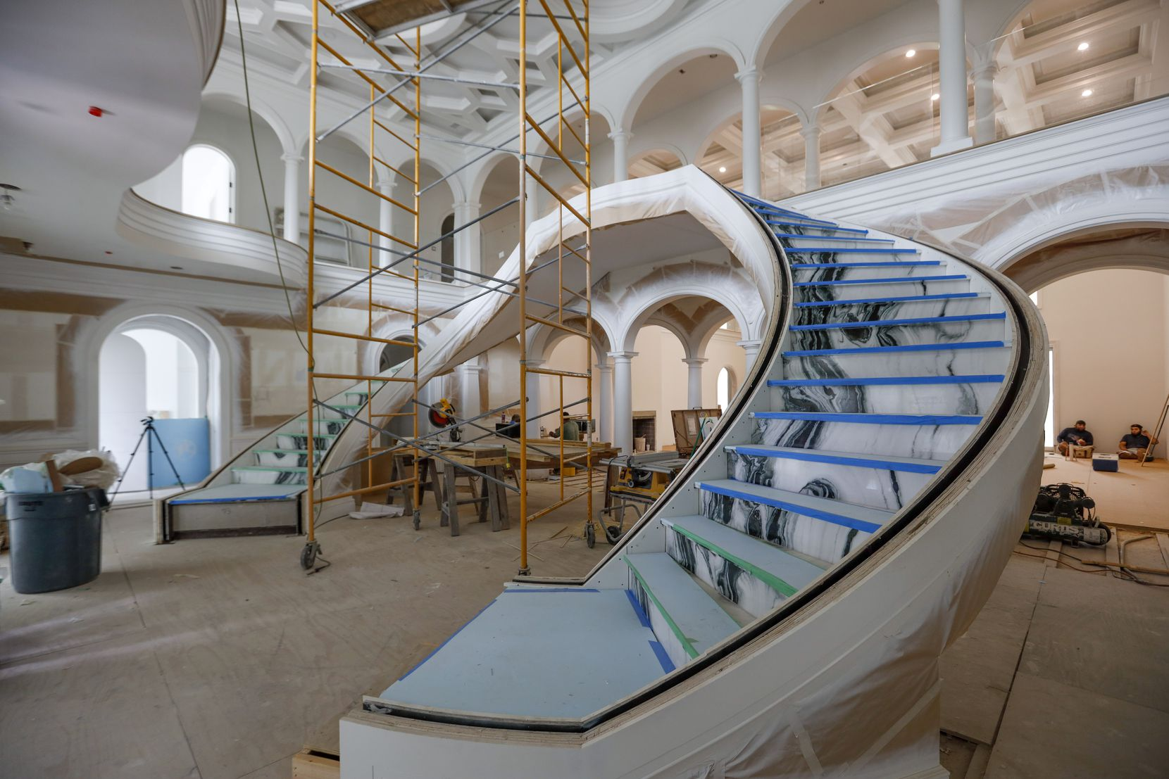 The grand double staircase in the entry will have black-and-white panda marble flooring.