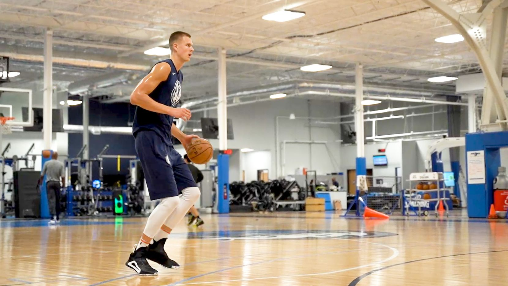 Dallas Mavericks power forward Kristaps Porzingis shoots baskets during the first mandatory workout on July 1, 2020. Porzingis and others played at the team's practice facility for the first time since the coronavirus pandemic started in Dallas, Tex.