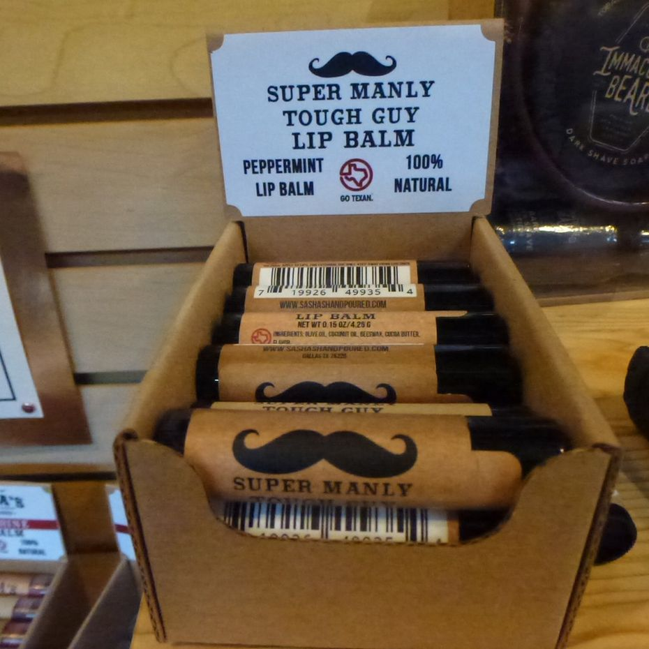 Among the many local-intensive stocking stuffers at Market Provisions: Sasha s Hand-Poured Bath, Body and Beard Care Super Manly Tough Guy Lip Balm.