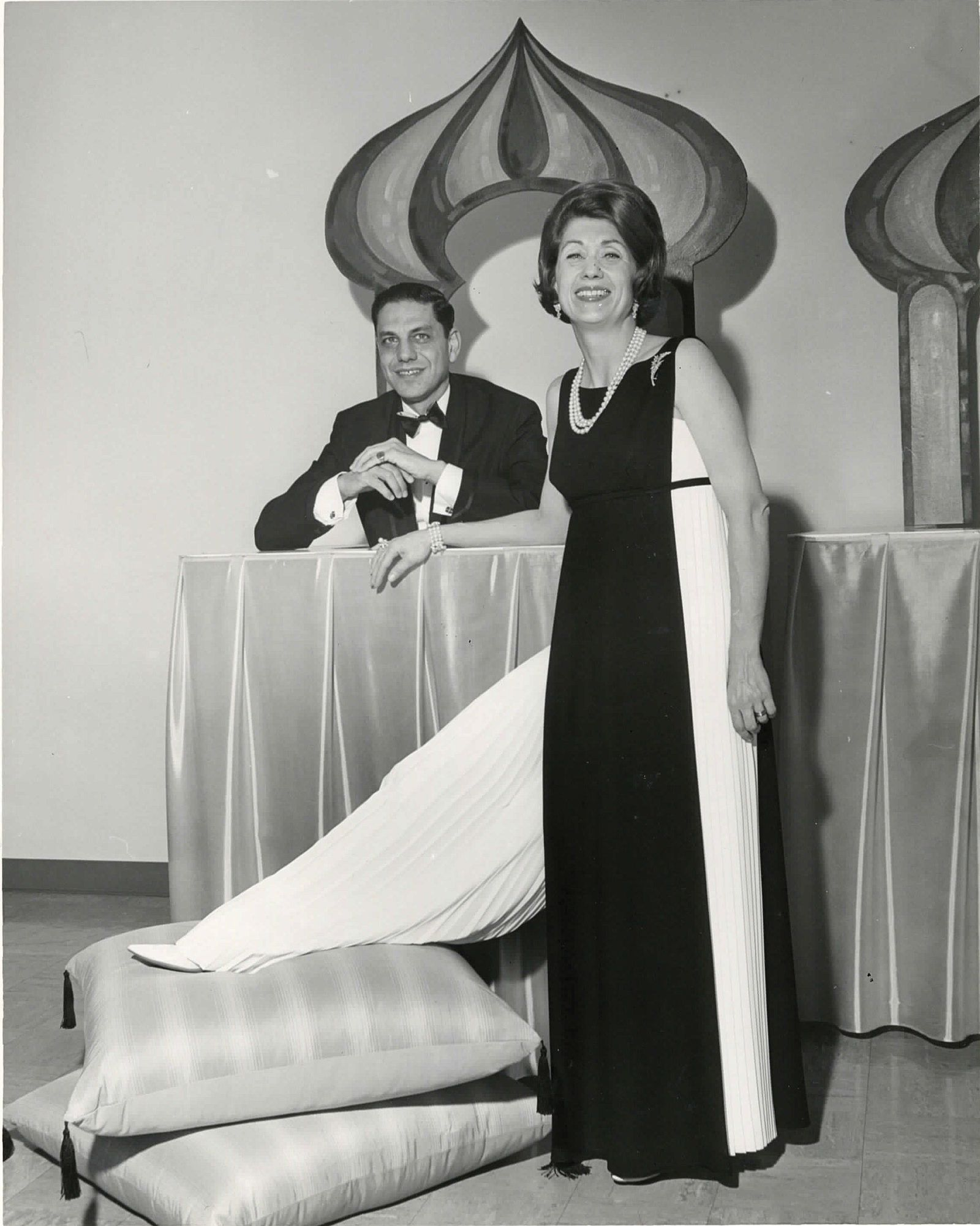 The founders of Eiseman Jewels, Dick and Louise Eiseman, posed for an infomercial about the Fine Arts Ball in 1967, which was themed on the Thousand and One Nights.