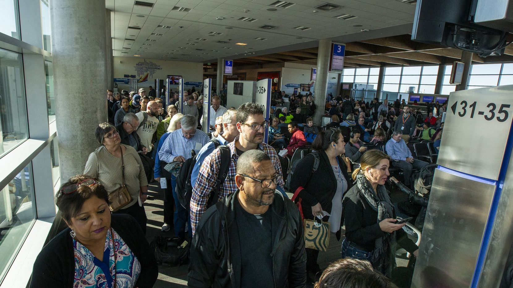 Travelers line up to board a flight at the Dallas Love Field airport on Thursday, Nov. 14, 2019. (Lynda M. Gonzalez/The Dallas Morning News)