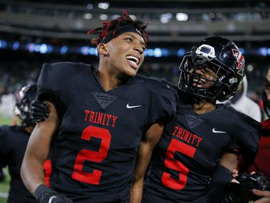 Euless Trinity junior running back Ollie Gordon (2) and junior defensive back Jayveus Lyons (5) celebrate a 49-45 win over Allen after a high school Class 6A Division I Region I semifinal football game at Globe Life Park in Arlington, Saturday, December 26, 2020. Trinity won 49-45. (Brandon Wade/Special Contributor)