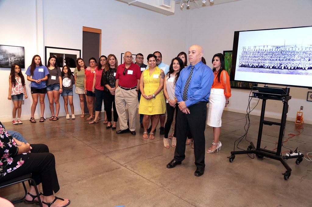 Dave Gutiérrez introduces the families of some of Company E soldiers who were present at his book signing.