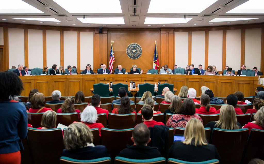 Members of the senate committee listen to public hearing on SB 3, which would give teachers a $5,000 pay raise next year, on Monday, Feb. 25, 2019, in Austin.