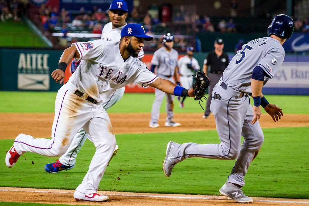 Texas Rangers shortstop Elvis Andrus (1) applies the tag as Tampa Bay Rays third baseman Matt Duffy (5) is caught in a rundown between third base and home during the second inning at Globe Life Park on Wednesday, Sept. 11, 2019, in Arlington. (Smiley N. Pool/The Dallas Morning News)