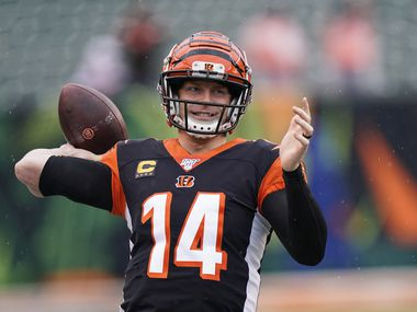 Cincinnati Bengals quarterback Andy Dalton warms up before an NFL football game against the Cleveland Browns, Sunday, Dec. 29, 2019, in Cincinnati.