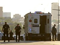 Law enforcement officers work the scene after Dallas police fatally shot a man Monday.