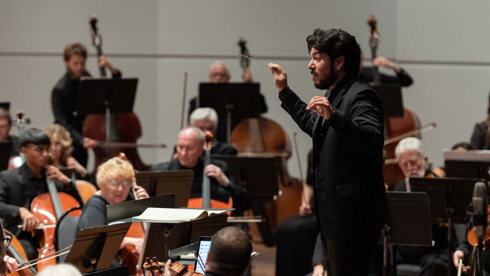 Mesquite Symphony Orchestra Music Director Felix Torres directs musicians during a performance at Mesquite Arts Center.