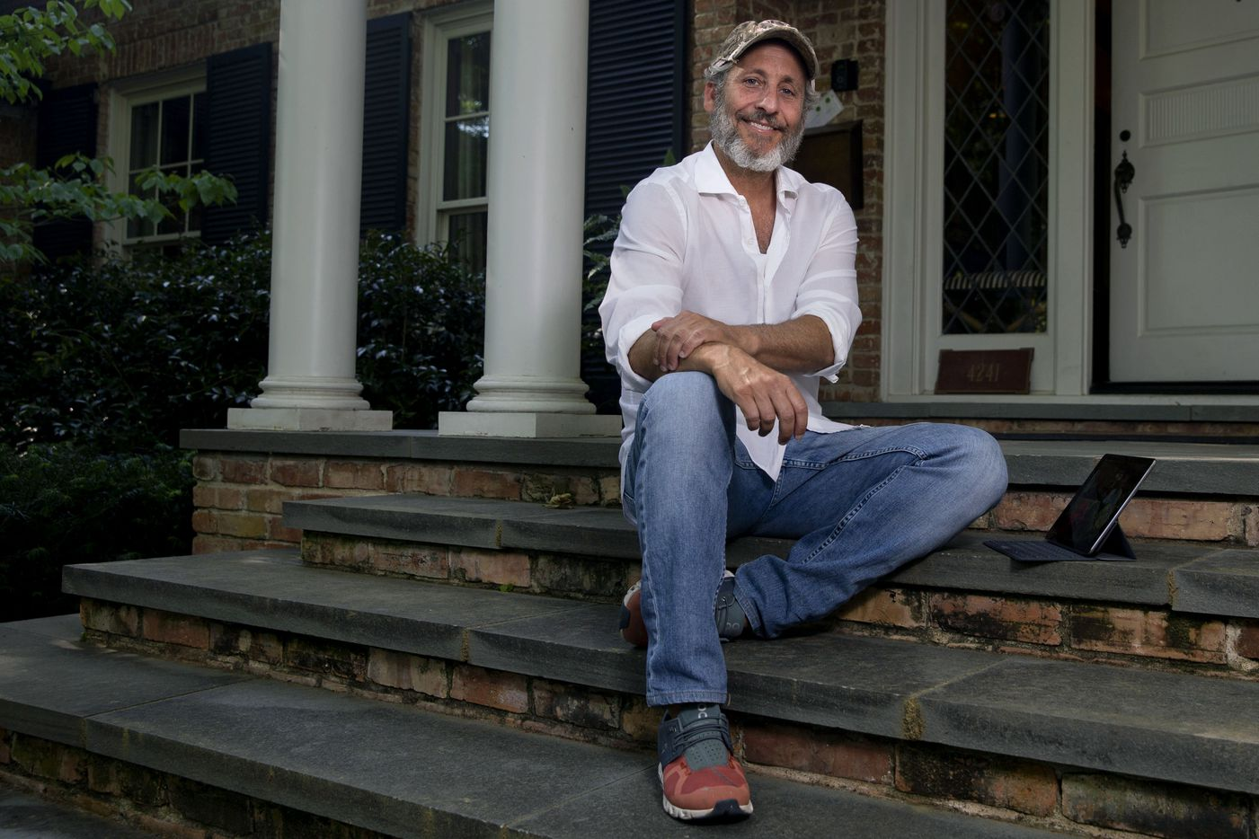 Adam Blumenfeld, CEO of Varsity Brands, poses for a portrait outside his home in Dallas on May 5. He says he's not shaving his beard until kids go back to school.