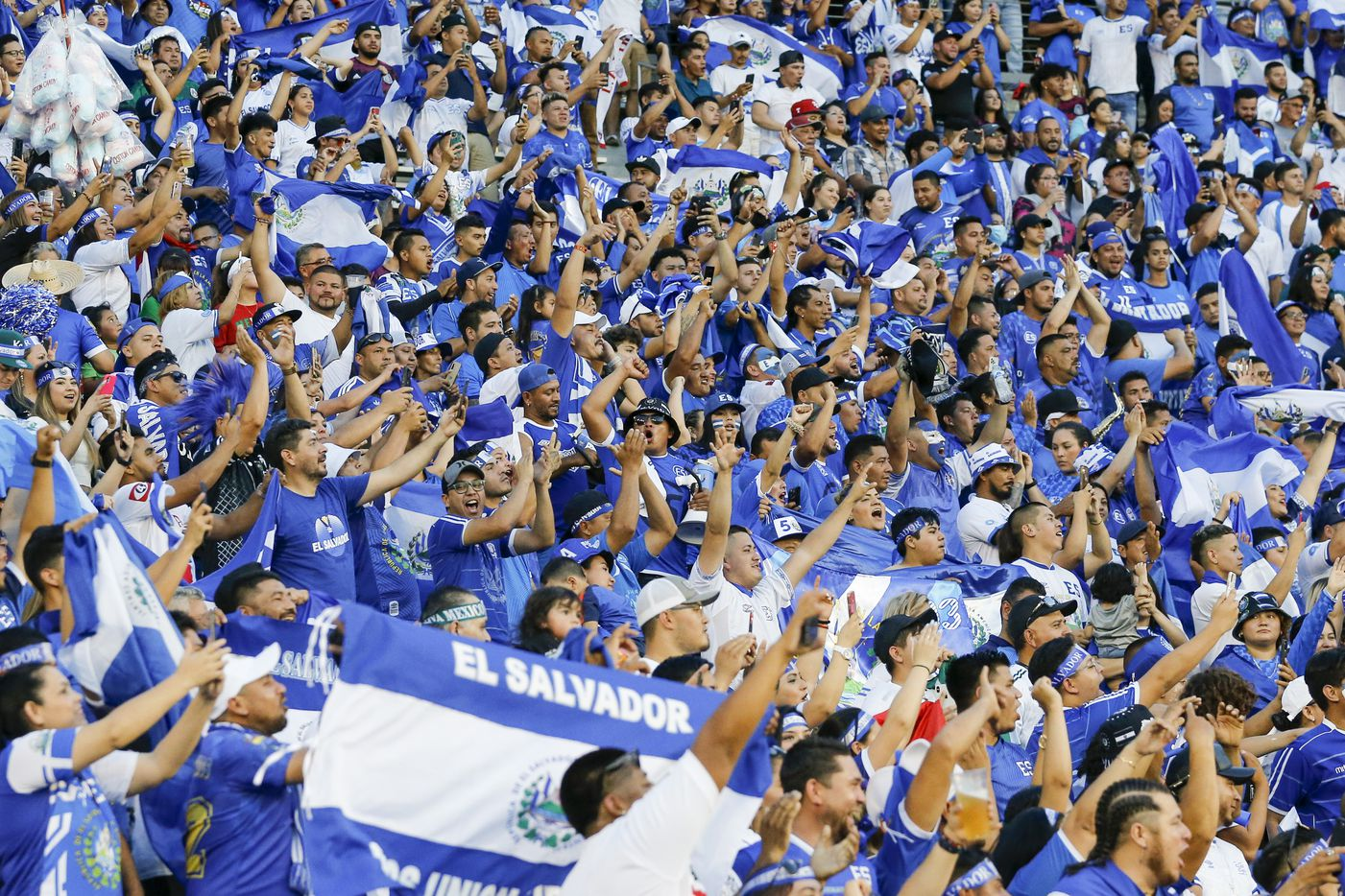 Fans of El Salvador cheer as the team walks onto the field before the first half of a CONCACAF Gold Cup Group A soccer match against Mexico at the Cotton Bowl on Sunday, July 18, 2021, in Dallas. (Elias Valverde II/The Dallas Morning News)