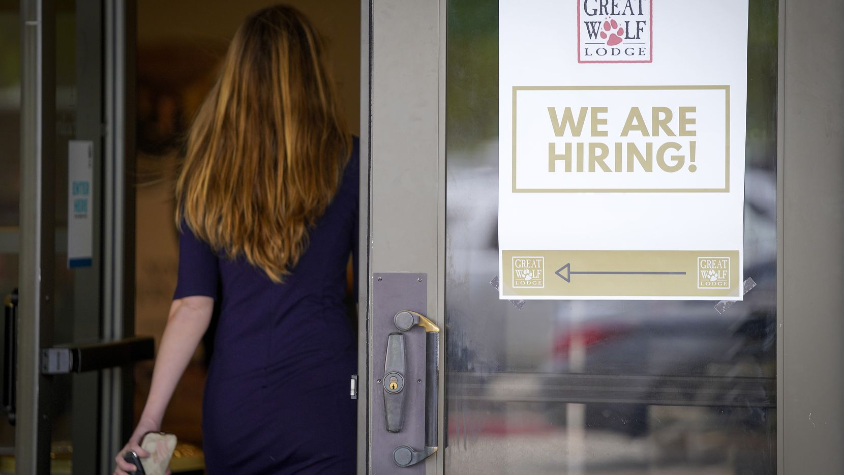 A sign directed job candidates to a hiring event at Great Wolf Lodge Grapevine in May.