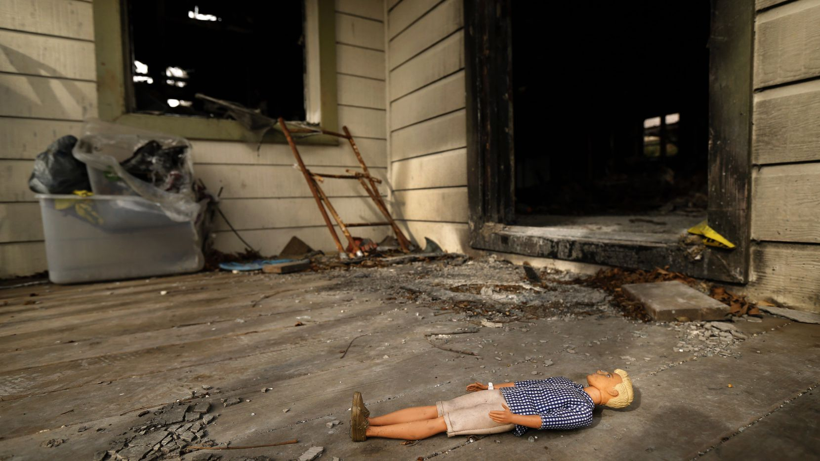"""A doll lies on the front porch of a burned out home on Durango Drive, March 8, 2019. The home burned after a gas leak caught fire, the same week that 12-year-old Linda """"Michellita"""" Rogers died in a gas explosion."""