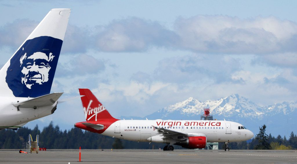 Alaska Airlines, which acquired Virgin Airlines last year, has been wanting to bolster its presence on the West Coast and announced plans Wednesday to add four daily flights out of Love Field to Seattle, San Diego, Portland, Ore., and San Jose, Calif. (File photo/The Associated Press)