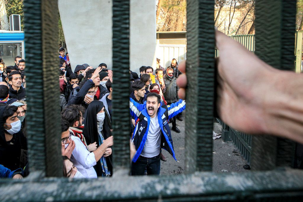 In this Dec. 30, 2017 file photo, taken by an individual not employed by the Associated Press and obtained by the AP outside Iran, university students attend an anti-government protest inside Tehran University, in Tehran, Iran. As nationwide protests have shaken Iran over the last week, the Islamic Republic increasingly has blamed its foreign foes for fomenting the unrest. So far though, there's no direct evidence offered by Tehran to support that claim. (AP Photo, File)