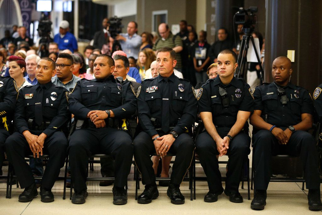 El Centro police officers sit in the front row during the Renewal and Resilience Commemorative Ceremony to honor the fallen officers in the July 7, 2016 ambush at El Centro College in Dallas on Friday, July 7, 2017.
