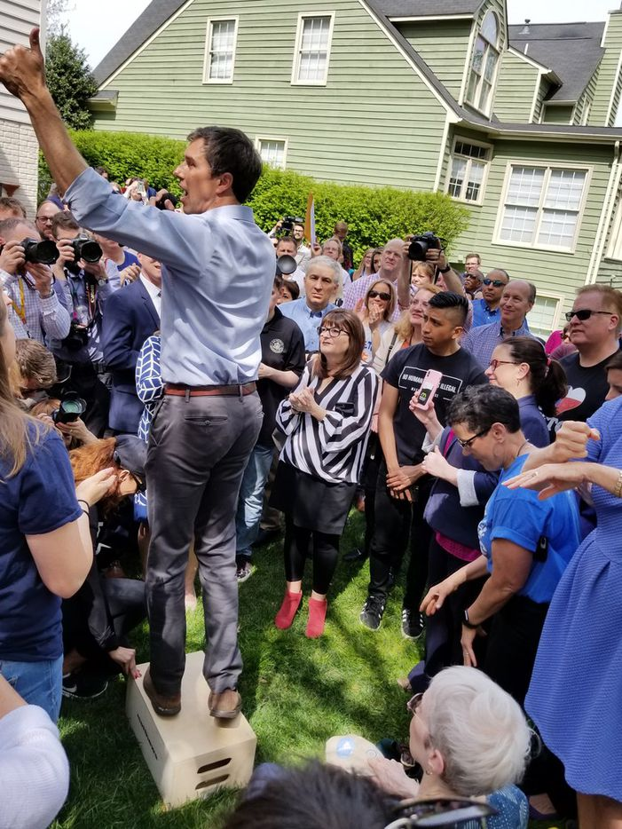 Beto O'Rourke stumps on a wooden box at a backyard house party in Alexandria, Va., on April 17, 2019.