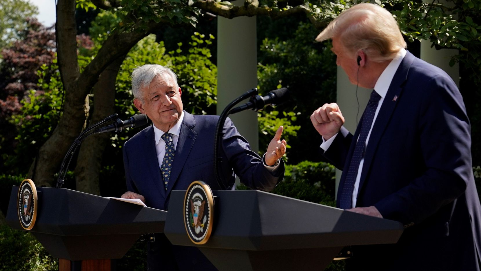 President Donald Trump and Mexican President Andres Manuel Lopez Obrador gesture before signing a joint declaration at the White House on July 8, 2020.