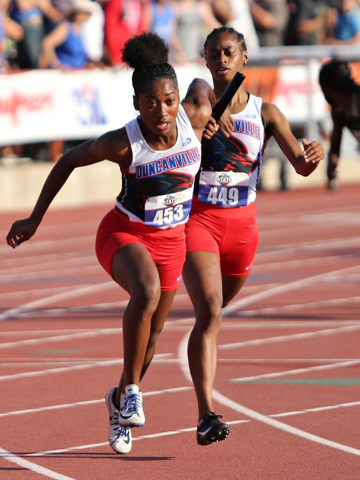 Duncanville's Laroncia Alexander hands off the baton to teammate Makhiya McDonald during their 6A Girls 4x200 meter relay during the UIL state track meet at the Mike A. Myers Stadium, at the University of Texas on May 8, 2021 in Austin, Texas.