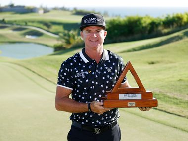 SOUTHAMPTON, BERMUDA - NOVEMBER 01: Brian Gay of the United States celebrates with the trophy after winning during a playoff in the final round of the Bermuda Championship at Port Royal Golf Course on November 01, 2020 in Southampton, Bermuda.