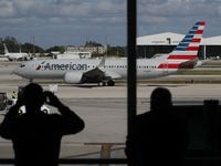 American Airlines flight 718, a Boeing 737 Max, pulls away from its gate at Miami International Airport on its way to New York on December 29, 2020 in Miami, Florida. The Boeing 737 Max flew its first commercial flight since the aircraft was allowed to return to service nearly two years after being grounded worldwide following a pair of separate crashes.