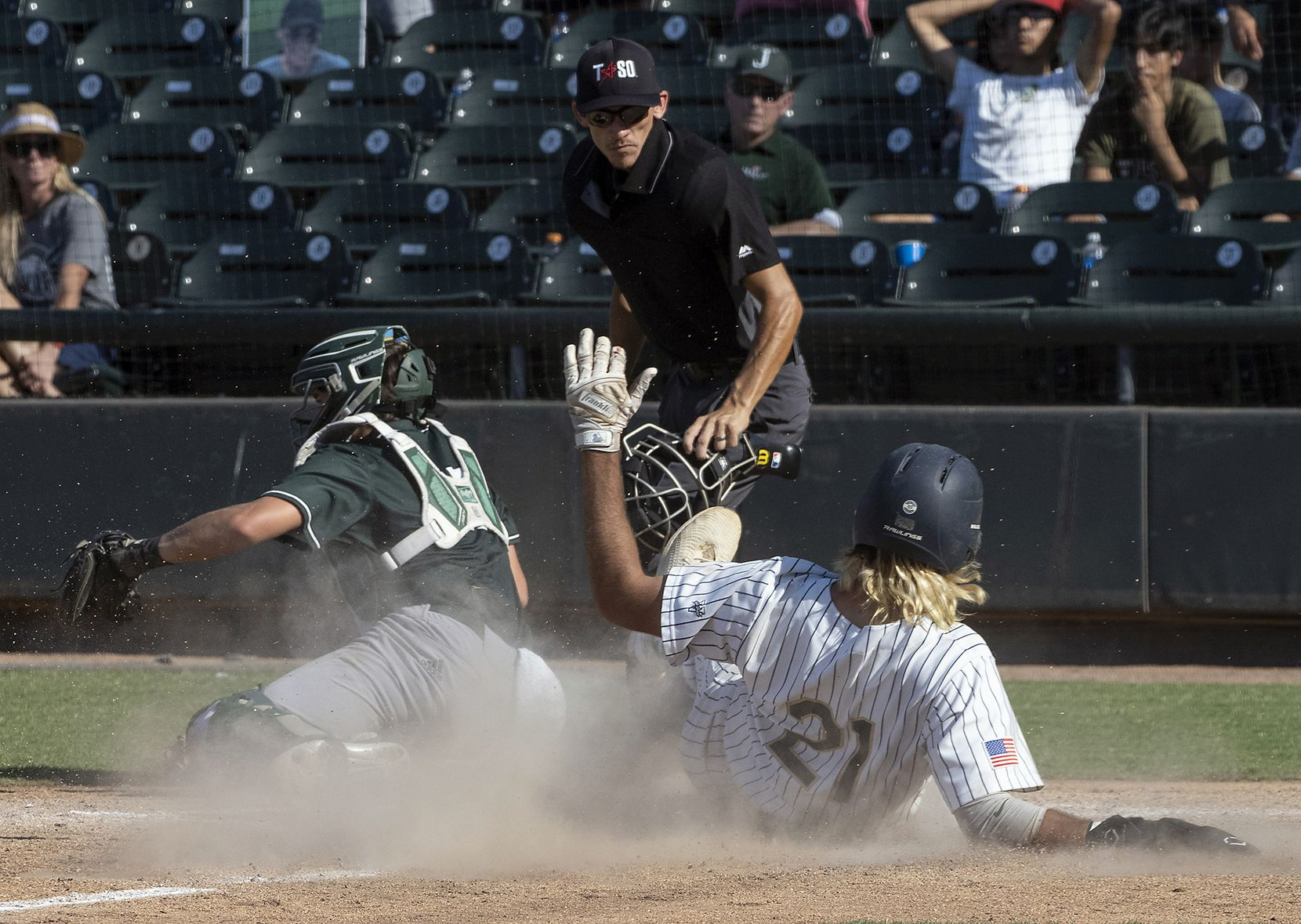 Keller Gray Rowlett, (21), slides safely into home plate as Houston Strake Jesuit catcher, Mike Dattalo, (15), is late on a tag during the fourth inning of the 2021 UIL 6A state baseball semifinals held, Friday, June 11, 2021, in Round Rock, Texas. Keller defeated Strake Jesuit 7-1.   (Rodolfo Gonzalez/Special Contributor)