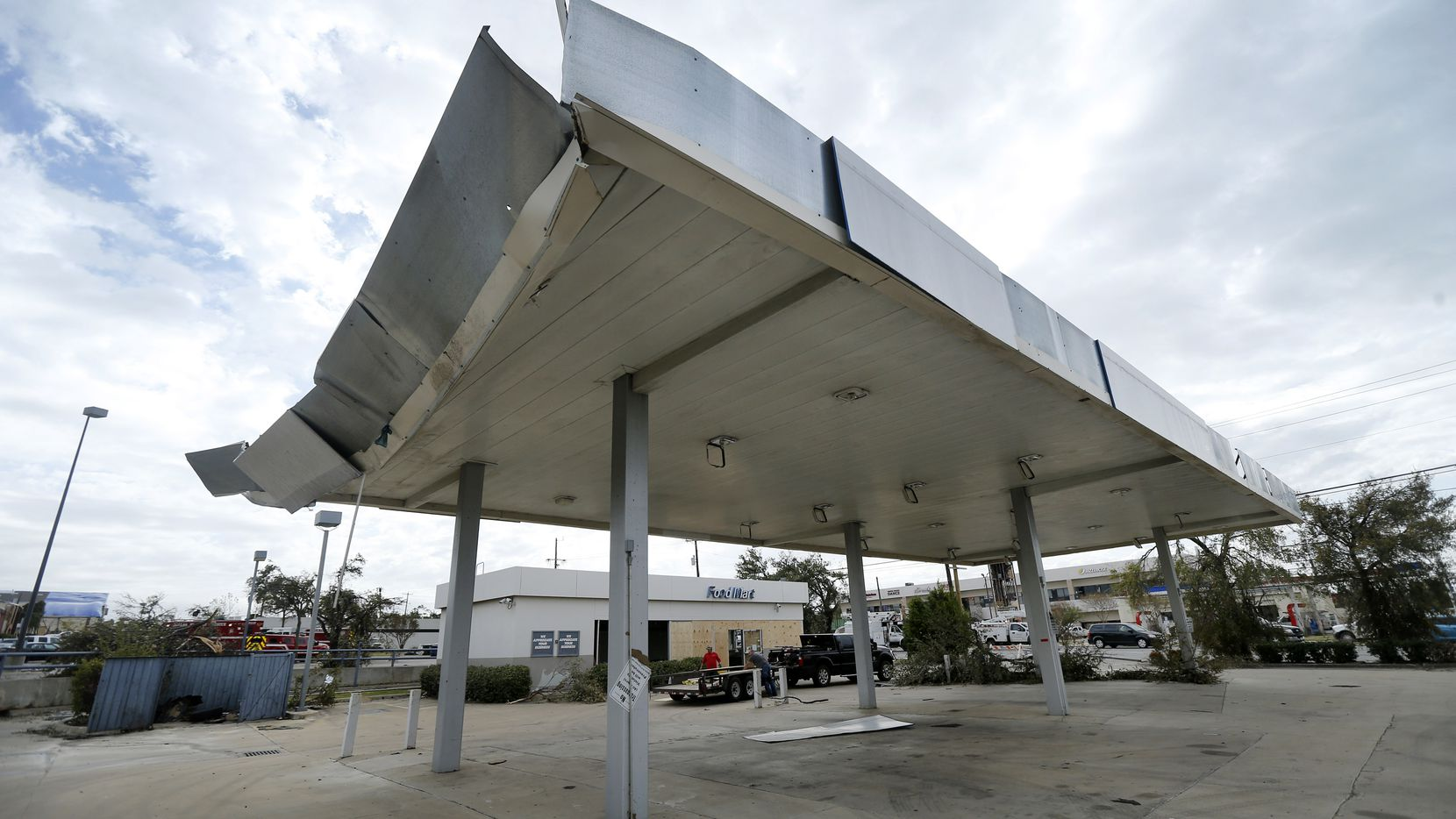 This abandoned gas station, long a source of code violations, sustained damage from the tornado that cut through the northeast corner of Marsh Lane and Walnut Hill Lane.