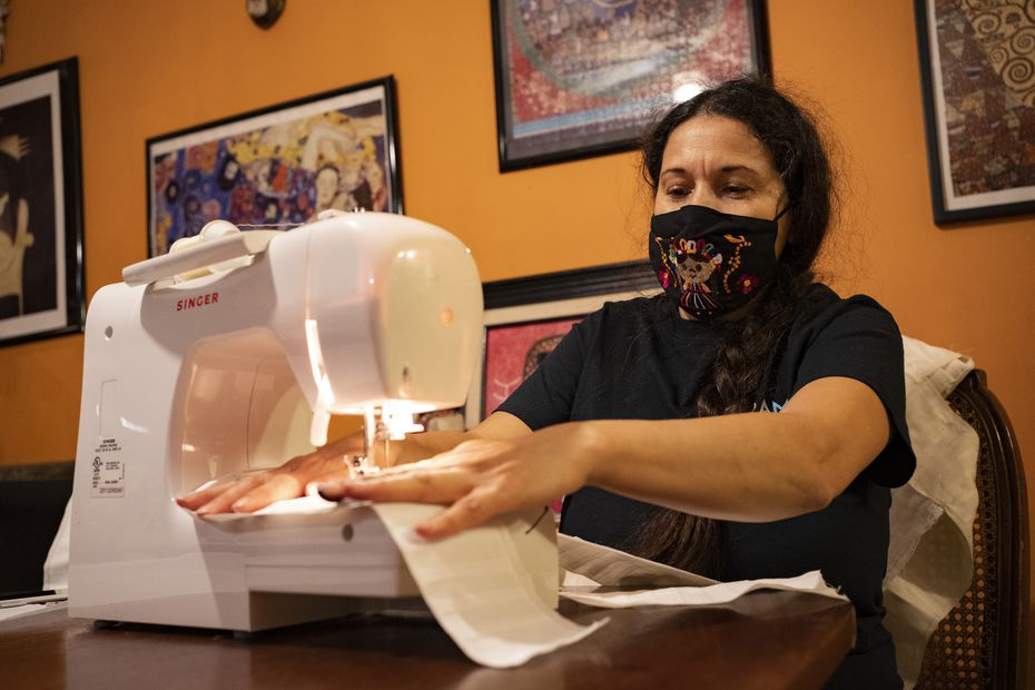 Frida Espinosa-Müller works on a Day of the Dead harness for puppets in Dallas. The puppets are part of a protest organized by Cara Mia Theatre and LULAC.