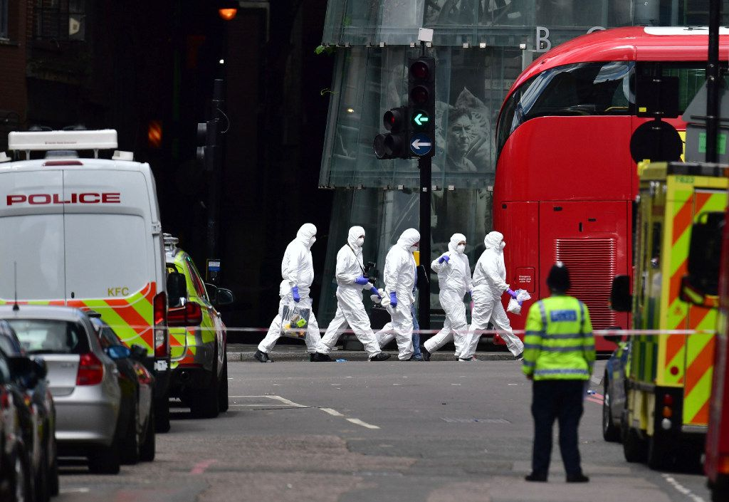 Police forensic officers outside Borough Market, London, Sunday June 4, 2017, near the scene of Saturday night's terrorist incident.