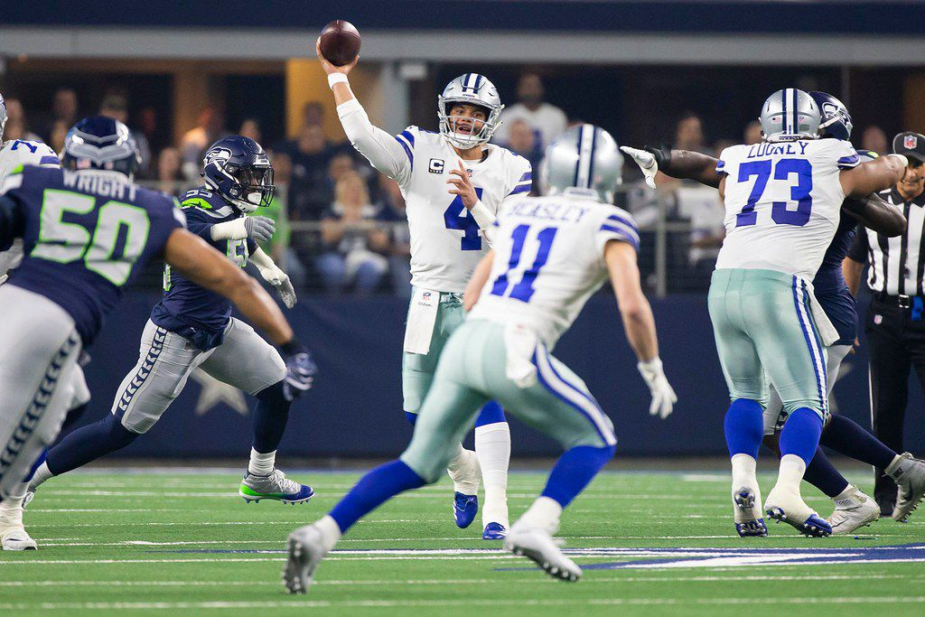 Dallas Cowboys quarterback Dak Prescott (4) throws a pass to wide receiver Cole Beasley (11) during the first half of an NFL wild-card playoff football game against the Seattle Seahawks at AT&T Stadium on Saturday, Jan. 5, 2019, in Arlington. (Smiley N. Pool/The Dallas Morning News)