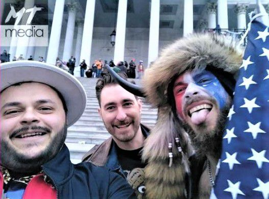 Nicholas DeCarlo (left) was arrested on charges related to his part in the U.S. Capitol building invasion.