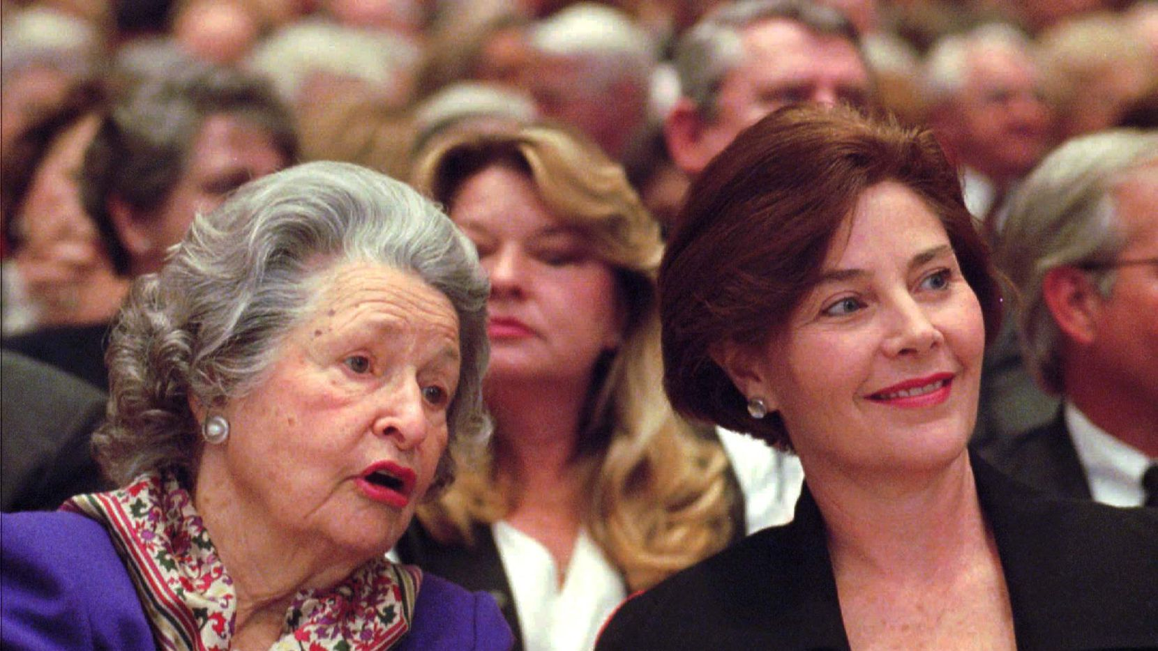 Former U.S. first lady Lady Bird Johnson, left, talks with Texas first lady Laura Bush during a speech by former President Gerald Ford Feb. 7, 1997, in Austin, Texas. Ford was speaking at the Lyndon Johnson Library as part of a lecture series.