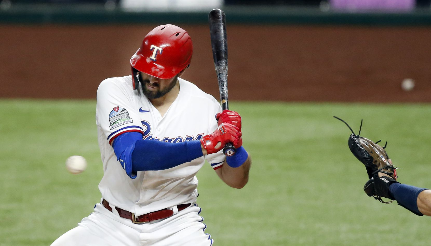Texas Rangers center fielder Joey Gallo (13) is hit on the arm by a pitch from Seattle Mariners starting pitcher Marco Gonzales (7) in the third inning at Globe Life Field in Arlington, Tuesday, August 11, 2020. (Tom Fox/The Dallas Morning News)