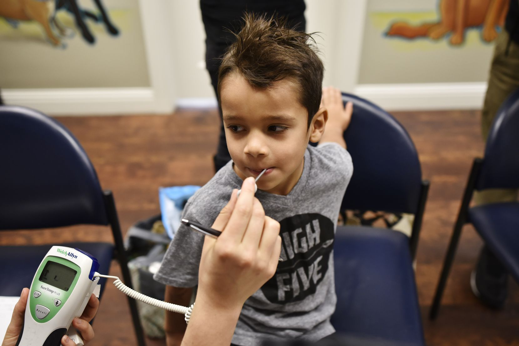 Samuel Bonilla had his vitals checked during an October visit to Agape Clinic, a private health center where no one is turned away because of tight finances.