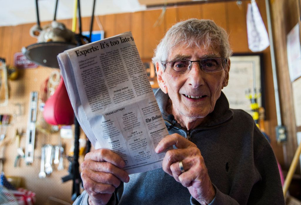 Norman Kantor, 90, poses for a portrait with the Texas Lottery numbers published in an issue of The Dallas Morning News on Wednesday, April 5, 2017 at his home in Plano, Texas. Kantor, who buys lottery tickets every day, had a theory about the number choice that turned out to be true, but research showed that the game is not rigged. (Ashley Landis/The Dallas Morning News)