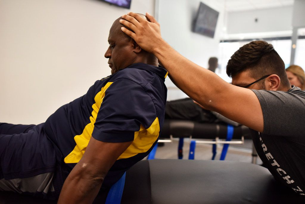 Stretch practitioner Shan Hussain works on client Sergeant Nathan Wilson, of the Dallas County Sheriff Department, as Hussain gently pushes on Wilson's neck during a session at Stretch Zone in Dallas, Wednesday, March 13, 2019. Ben Torres/Special Contributor
