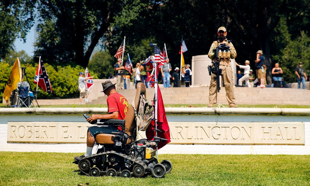 Dallas Marine Danny Spaulding, a Vietnam veteran, uses his motorized chair, Monster, to get around the This Is Texas Freedom Force protest Saturday over the removal of the Robert E. Lee statue from Lee Park in Dallas. The statue was removed from Lee Park on Thursday.