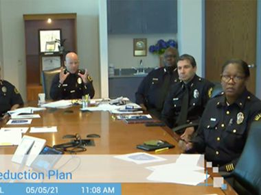 A screengrab of Dallas Police Chief Eddie Garcia, center, as he talks during a virtual Dallas City Council briefing meeting on May 5, where he presented his Violent Crime Reduction Plan.