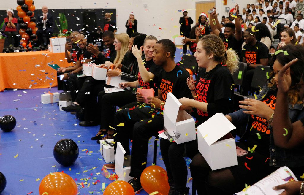 Billy Earl Dade Middle School teachers were surprised with $400 Target gift cards and letters from their students on Wednesday, December 14, 2016 in Dallas. An anonymous donor provided gifts to the teachers in recognition of their efforts and success at improving extraordinary student educational outcomes. (David Woo/The Dallas Morning News)