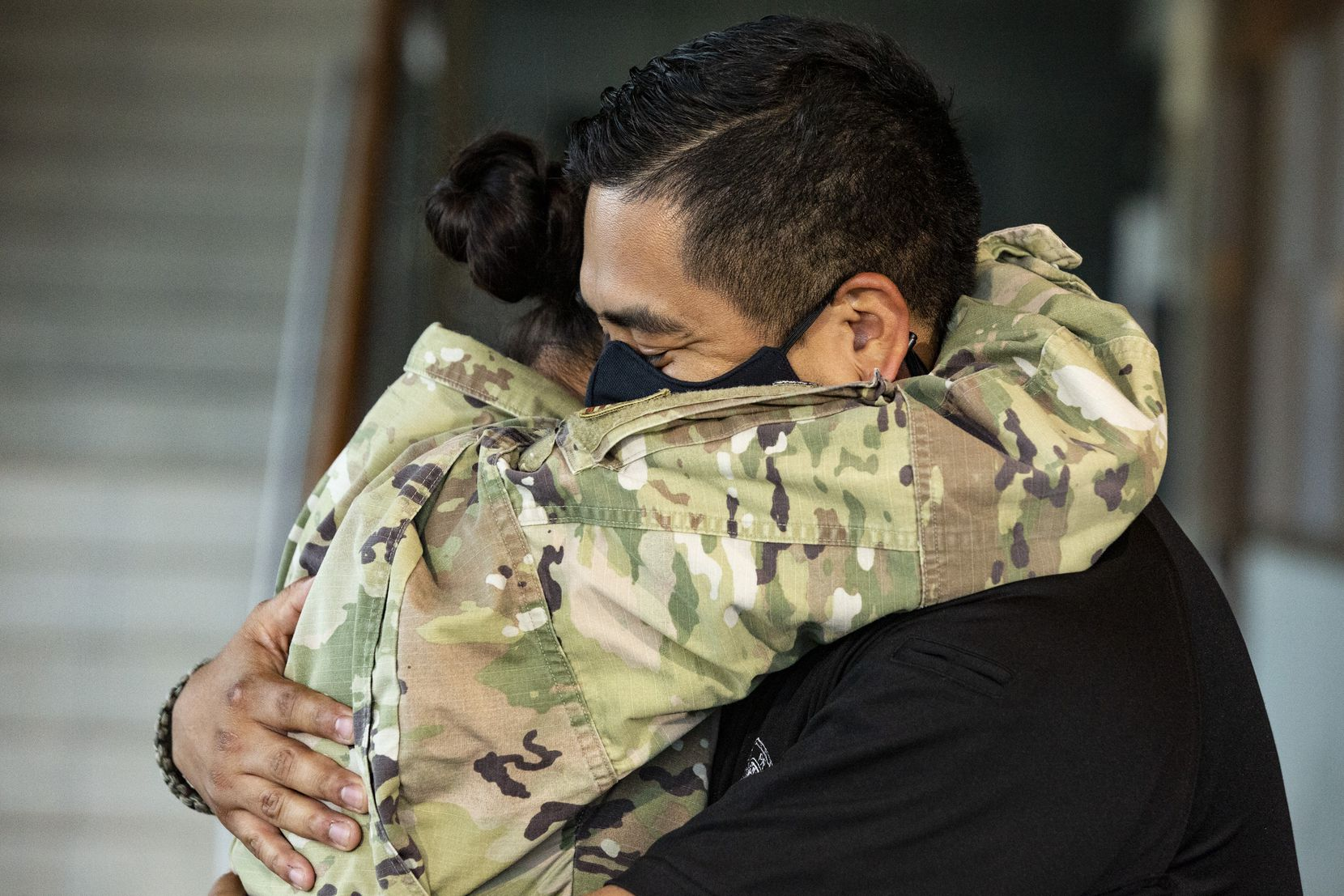 What else but a long hug upon the realization that your wife is safely home? Grand Prairie police Officer Edgar Molina got to do just that when his wife, Air Force Senior Master Sgt. Viviana Molina, surprised him at police headquarters by arriving home from a six-month deployment in Iraq.