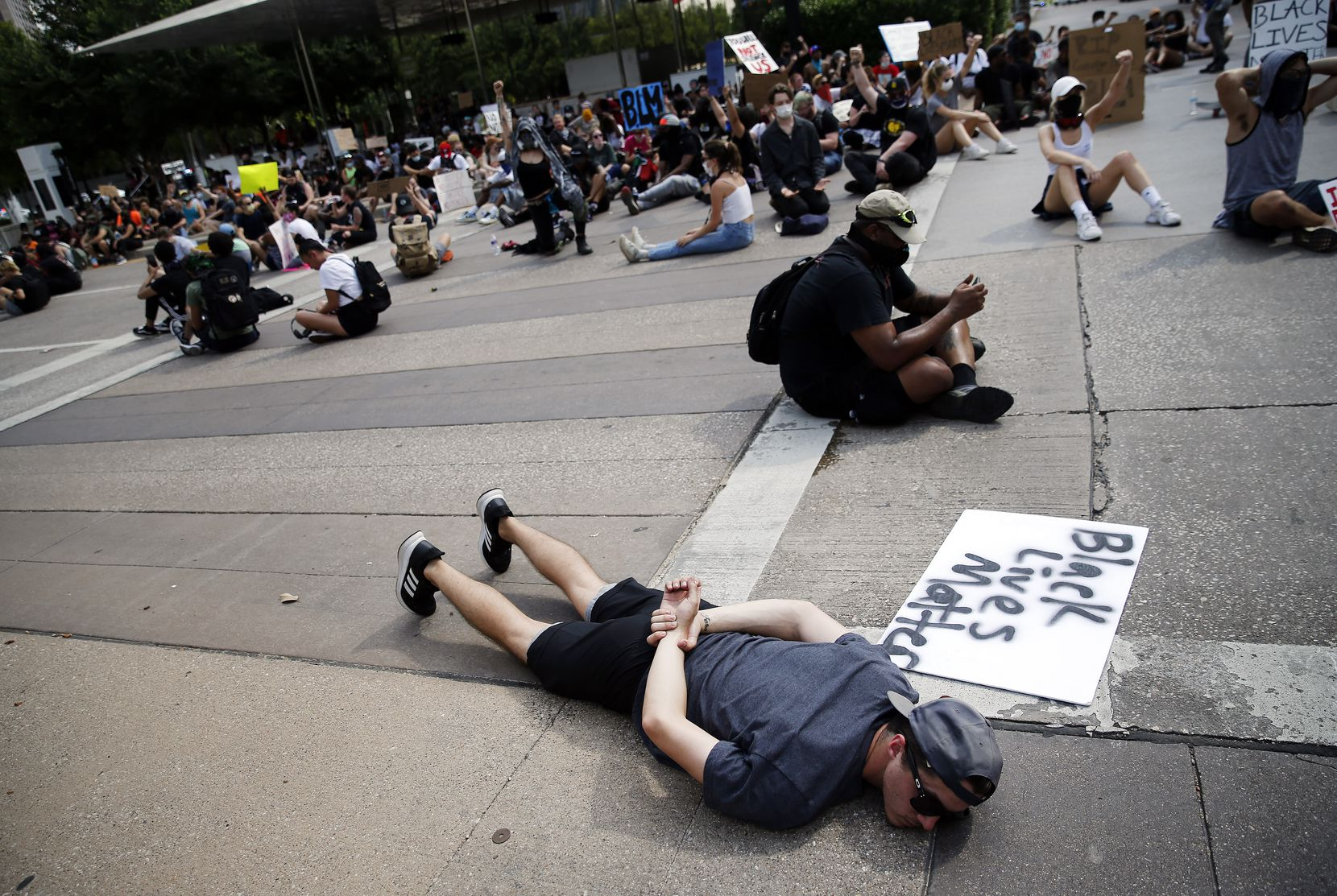 Protestors supporting Black Lives Matters block an intersection at Klyde Warren Park for 8 minutes and 46 seconds, the time it took for the in-custody death of George Floyd. The march wound through downtown Dallas, Tuesday, June 2, 2020.