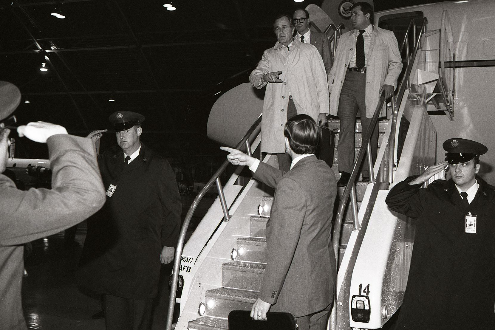 1981: While sharpshooters watched from the hangar roof, Vice President Bush arrives at Andrews Air Force Base from Texas after the assassination attempt on President Reagan.
