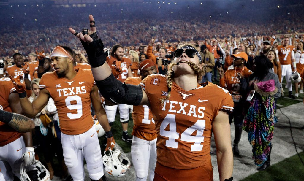 Texas defensive lineman Breckyn Hager (44) celebrates the team's win over Iowa State with teammates in an NCAA college football game, Saturday, Nov. 17, 2018, in Austin, Texas. (AP Photo/Eric Gay)