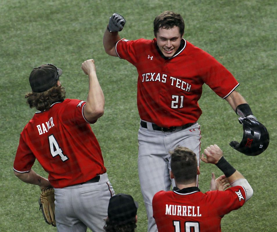 Texas Tech freshman infielder Nate Rombach (21) celebrates with teammates Dru Baker (4) and Easton Murrell (19) after hitting a home run to break a scoreless tie in the 2nd inning of their game against Ole Miss. Rombach is a product of Mansfield Legacy. Texas Tech played Ole Miss in conjunction with the State Farm College Baseball Showdown tournament held at Globe Life Field in Arlington on February 21, 2021. (Steve Hamm/ Special Contributor)