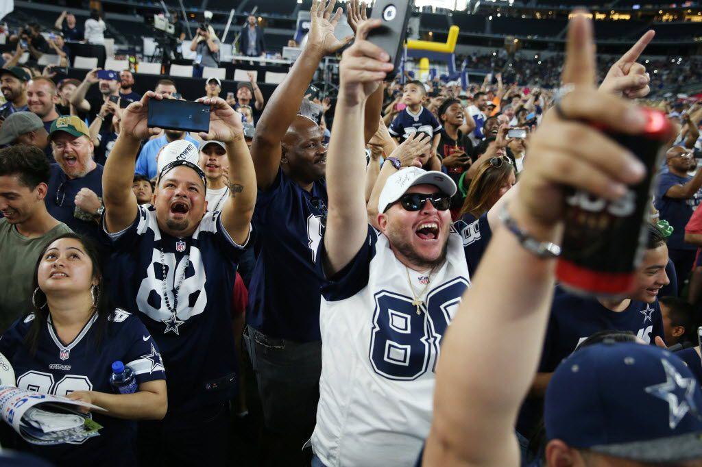 Mario Flores (back left) and Juan Trevino (center), both of Dallas, react with other fans during a watch party moments after the Dallas Cowboys pick running back Ezekiel Elliott, of Ohio State, in the first round of the 2016 NFL Draft at AT&T Stadium in Arlington, Texas Thursday April 28, 2016.