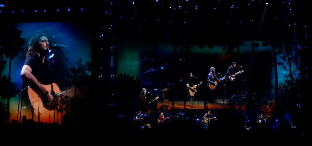 Members of the iconic band the Eagles are accompanied by larger than life images projected live on large screens as they performed a song during their set. Chris Stapleton, who opened the show and the Eagles performed before a  capacity crowd of their fans at AT&T Stadium in Arlington on June 23, 2018. (Steve Hamm/ Special Contributor)