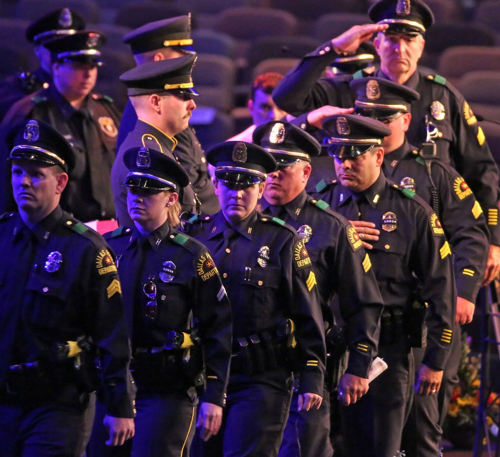 Dallas police officers pay their final respects to slain Dallas Officer Rogelio Santander at the funeral service at Lake Pointe Church in Rockwall.