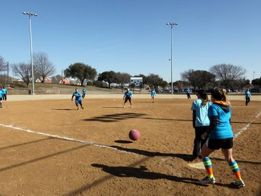 """In this 2014 file photo, """"Schweddy Balls"""" competes against """"Balls and Dolls"""" during the North Texas Food Bank Kickball Tournament at the Josey Ranch Athletic Complex in Carrollton. In Garland, an adult kickball league kicks off next month."""