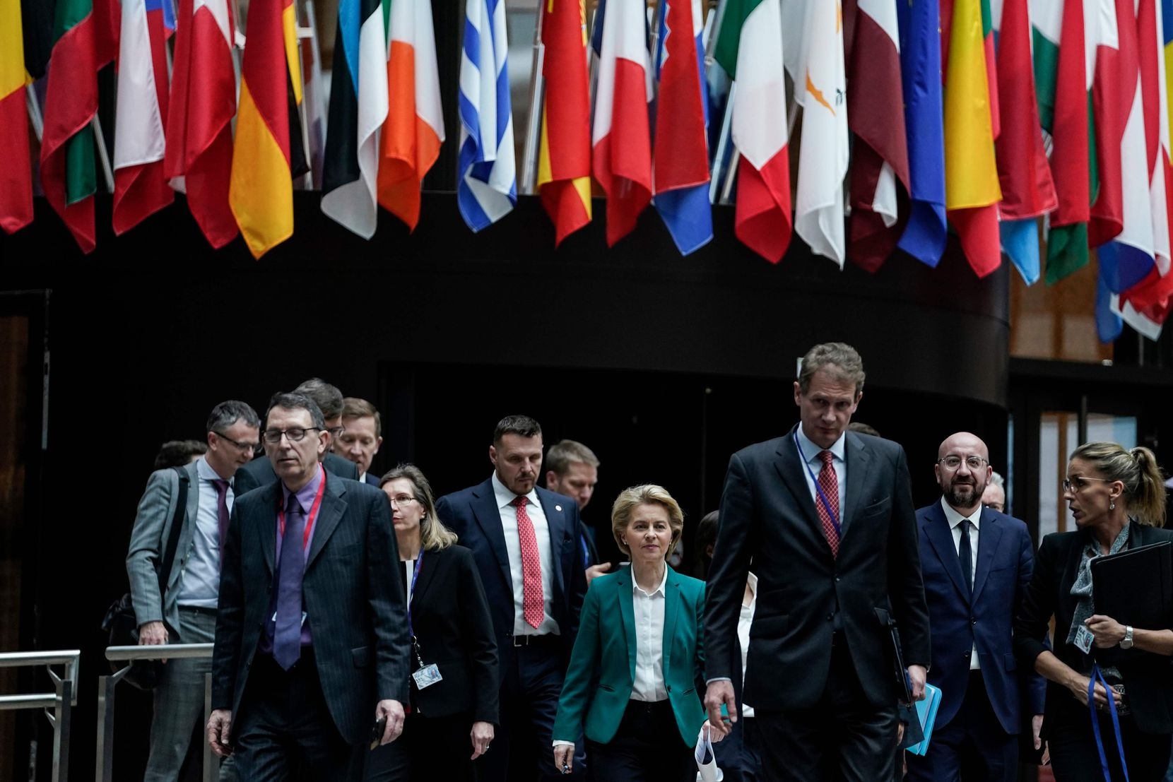 EU President of Council Charles Michel (second from right) and European Commission President Ursula von der Leyen (center) arrive to give a joint press conference after a G7 Leaders' videoconference on COVID-19 at the EU headquarters in Brussels.